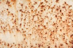 rusty iron sheet with the peeled paint and corrosion stains - stock photo