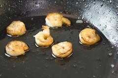 Skillet fried shrimp closeup Stock Photos