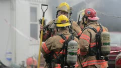 Firefighters after a fire Stock Footage