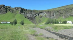 Iceland south cliffs with small fall zoom in  Stock Footage