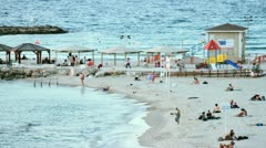 637b extreme long of tel-aviv beach in swimming season in stop motion Stock Footage