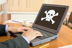 laptop with pirate software - stock photo