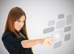 businesswoman pushing button on screen interface - stock photo