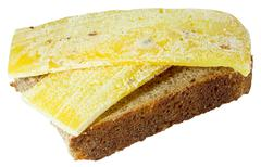 Spoiled moldy inedible sandwich with cheese on white background Stock Photos
