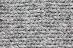 Gray knitted fabric background Stock Photos