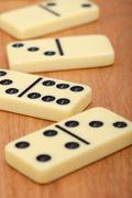 Bones of dominoes on wooden background close up Stock Photos