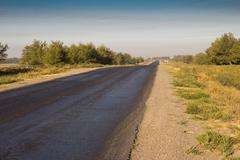 Asphalt road in the morning Stock Photos