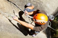 Rock Climber Close Up Shoot From Above - stock photo