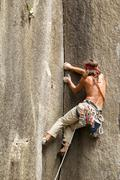 Rock Climbing On A Perfect Vertical Plane Rock - stock photo