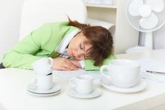 Office worker has fallen asleep despite drunk by coffee Stock Photos