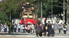 Camera crew films Japanese parade during festival Stock Footage