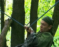 Young soldier is training in difficult conditions in forest - PAL Stock Footage