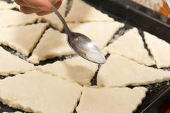 dough on a baking sheet on the cookie - stock photo