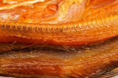 Stock Photo of smoked fish as a background