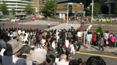 Crowds gather to watch the opening of a matsuri (festival) in Japan - stock footage