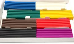 multicolored plasticine on a white background - stock photo