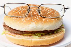 Stock Photo of jolly clever sandwich with glasses