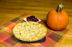 Turkey pot pie with pumpkin and cranberries Stock Photos
