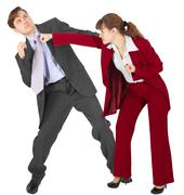 Woman punches a man - an unexpected denouement dispute Stock Photos