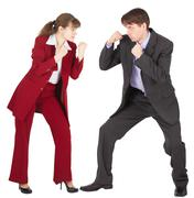 man and woman in business suits are going to fight - stock photo