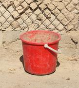 Old red plastic bucket Stock Photos