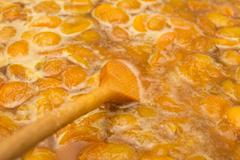 apricot jam in the background - stock photo