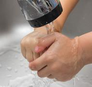 boy washes his hands - stock photo