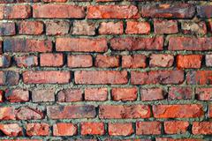 Old dilapidated brick wall - background Stock Photos