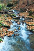 Rocky autumn stream Stock Photos