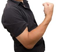 man shows strength on a white background - stock photo