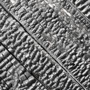 wooden wall blackened after fire - texture - stock photo