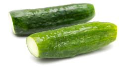 Salted cucumber on white background Stock Photos