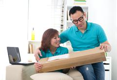 asian chinese couple receiving online package - stock photo