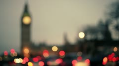 Traffic lights bokeh under the Big Ben, London, at sunset Stock Footage