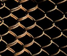 rusty grid on a black background - stock photo