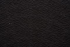 A dark rag material as background Stock Photos