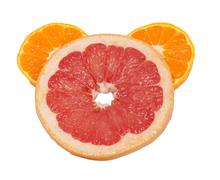 Grapefruit and oranges on a white background Stock Photos