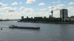 Netherlands Rotterdam boat passes barge in front of Euromast Stock Footage