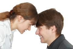 Serious confrontation between men and women Stock Photos