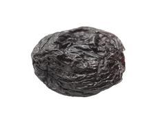 black raisins on a white background - stock photo