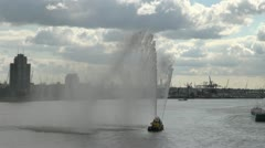 Netherlands Rotterdam geyser and mist from fireboat on Maas Stock Footage