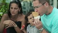 Stock Video Footage of Happy family eating ice cream, steadicam shot HD