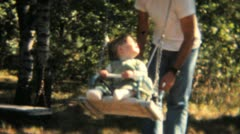 Dad Pushes Daughter On Swing-1968 Vintage 8mm film Stock Footage