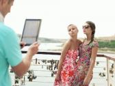 Friends taking photo with tablet computer on vacations, steadicam shot NTSC Stock Footage