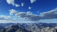 Flying through the clouds and the mountains Stock Footage