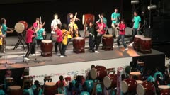 Traditional drum band on stage during a nightly festival in Japan Stock Footage