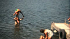 Family Swimming Off The Dock-1968 Vintage 8mm film - stock footage