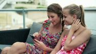 Young female friends with smartphone in the city, steadicam shot HD Stock Footage