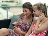 Young female friends with smartphone in the city, steadicam shot NTSC Stock Footage