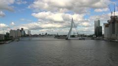 Netherlands Rotterdam Erasmus Bridge pan to rooftop cranes Stock Footage